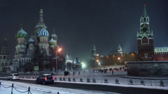 Cars ride near Kremlin and St. Basil Cathedral on Red Square Stock Footage