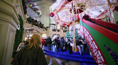 Many people walk near slide at shopping center GUM Stock Footage