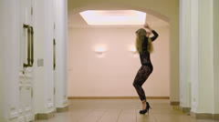Attractive girl in lace dress dances slowly in foyer Stock Footage
