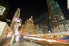 Evening traffic on michigan avenue at the chicago river Stock Photos