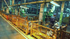 Men work on machine tools at components production line Stock Footage