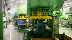People work on press machines at car components production line - stock footage