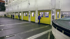 Workers in workshop with stamping line at Avtovaz factory Stock Footage