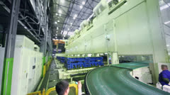 People watch stamping line at Avtovaz factory Stock Footage