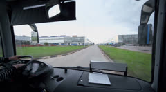 Bus rides by road among buildings of large factory Stock Footage
