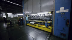 Worker controls machine and then check it at Avtovaz factory Stock Footage