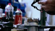 Stock Video Footage of mechanic working on car part