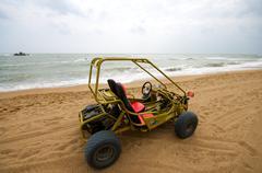 atv on the beach fun - stock photo
