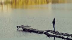 Man Standing on a Dock Stock Footage