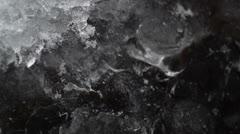 melt water running underneath ice - stock footage