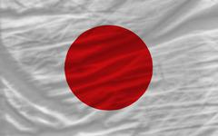 Stock Photo of complete waved national flag of japan for background