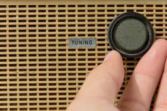 Stock Photo of hand with tuner radio knob