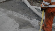 Stock Video Footage of road worker using compressed air