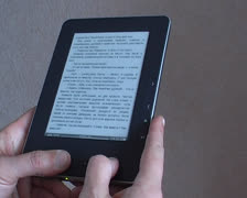 Hand switches page ereader Stock Footage