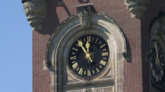 Clock stands at five minutes to twelve - zoom out Peace Palace Stock Footage