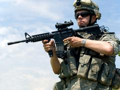 Soldier aiming his rifle Stock Photos