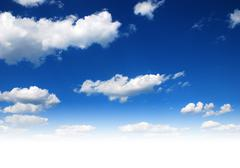 Blue sky with clouds Stock Photos