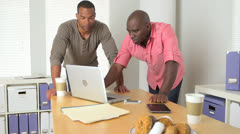 Black businessmen working in office Stock Footage