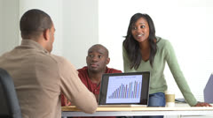 Two Black Business partners listening to their team leader - stock footage