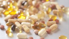 Food supplements falling slow motion Stock Footage