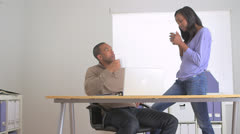 Two black co-workers talking in the office Stock Footage