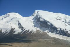 Glaciers on the summit of mount Muztag Ata, the father of ice mountains  Stock Photos