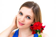 Woman with a flower and thinking about love Stock Photos