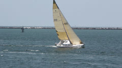 White Sailboat Tacking Into Wind - stock footage