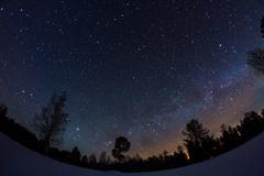 starry sky in winter - stock photo