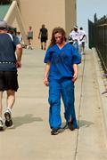 Female zombie nurse skulks after runners in 5k run Stock Photos