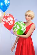 Girl with balloons - stock photo