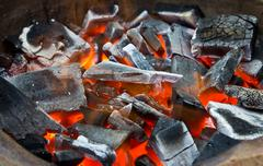 coals in the fire - stock photo
