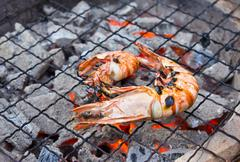 grilled shrimp on the stove - stock photo