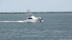 Sport Fishing Boat Enters Harbor Stock Footage