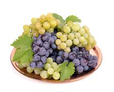 black and white grapes in a  metal bowl isolated white background,drops - stock photo