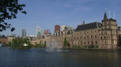 Swift zoom The Hague Binnenhof + modern office buildings Dutch ministries Stock Footage