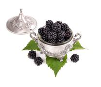 fresh blackberry  in a metal bowl  isolated on white background . - stock photo