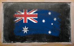 flag of australia on blackboard painted with chalk - stock photo