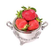 strawberries in metal bowl isolated on white background - stock photo