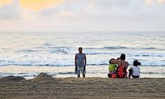 Indian family catch sunrise at beach Stock Photos