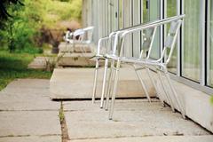 Alumina folding chairs on garden patios Stock Photos