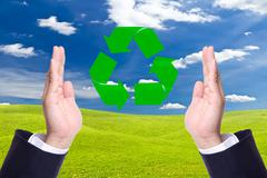 business man hand and recycle sign for green world concept - stock photo