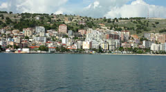 High rise apartment blocks on the sea front at Sarande in Albania - stock footage