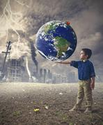 young boy holds the world - stock photo