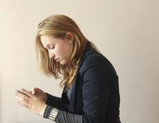 young woman with touch screen cell phone - stock photo