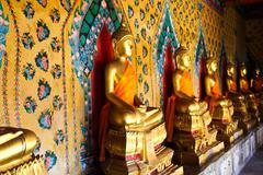 buddha statue at wat arun bangkok thailand. - stock photo