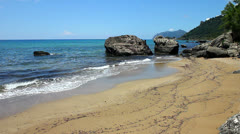 Sandy beach in a small cove at Agios Gordis in Corfu - stock footage
