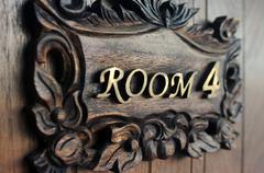 closeup shot of a hostel door room 4 - stock photo
