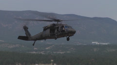 Blackhawk helicopter landing for fuel Stock Footage