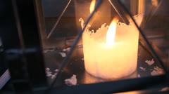 Big white candle in lantern Stock Footage